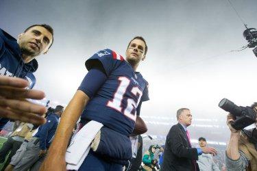 Patriots Brady hugs Falcons Ryan