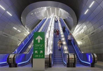Israelis Ride Escalator To The Platforms Of The New Jerusalem Fast Train