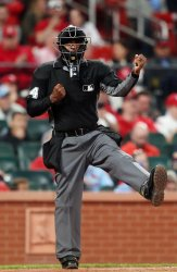 Home plate umpire Alan Porter calls Milwaukee Brewers Christian Yelich out on strikes