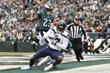 Seahawks wide receiver Malik Turner (17) catches the ball for a touchdown
