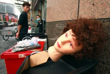 A Western-looking mannequin's head sits outside a salon in Beijing