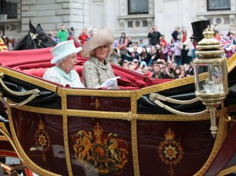Queen Elizabeth II rides in the Royal Carriage during the Royal Diamond Jubilee procession in London.