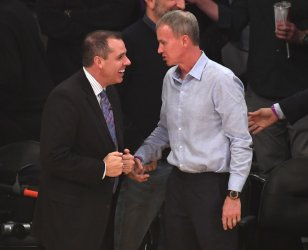 Lakers head coach Frank Vogel (L) shake hands with USC Trojans mens head basketball coach Any Enfield prior to game
