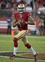 49ers QB Colin Kaepernick rolls to pass in loss to Seahawks