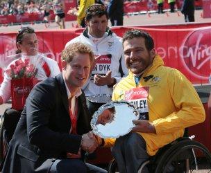 Prince Harry congratulates Kurt Fearnley the Mens 2013 London Marathon Wheelchair Winner