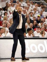 Wolverine head coach Juwan Howard reacts to his teams play