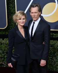 Kyra Sedgwick and Kevin Bacon attend the 75th annual Golden Globe Awards in Beverly Hills