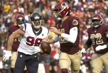 Redskins quarterback Colt McCoy is sacked