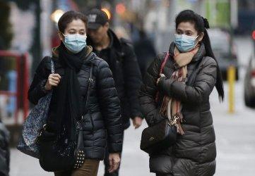 Chinatown pedestrians wear face masks in New York