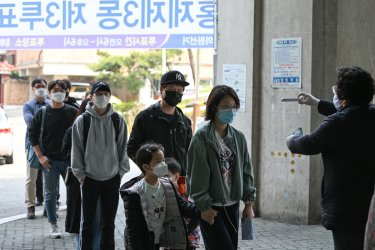 Voters in South Korea Wear Face Masks During a National Election