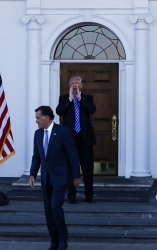President elect Donald Trump and Vice President elect Mike Pence greet Mitt Romney