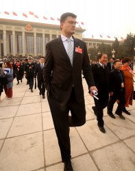 Yao leaves the CPPCC in Beijing, China