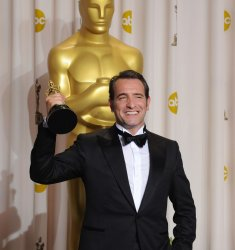 Best Actor Oscar winner Jean Dujardin holds his Oscar backstage at the 84th annual Academy Awards at the Hollywood and Highlands Center in Los Angeles