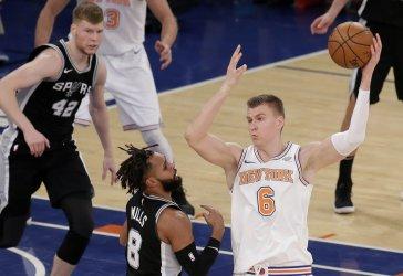 New York Knick Michael Beasley passes the basketball