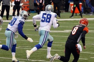 CowboysA ldon Smith runs a fumbled football back for a touchdown