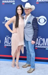 Kate Moore and Justin Moore attend the Academy of Country Music Awards in Las Vegas