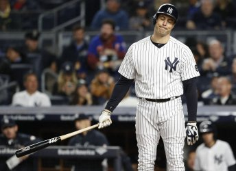 New York Yankees Mark Teixeira reacts after a swing