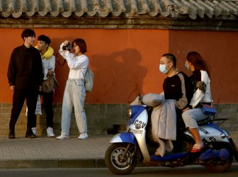 Chinese students are not wearing face masks in Beijing, China