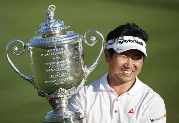 Y. E. Yang of South Korea poses with the Rodman Wanamaker Trophy after winning the 91st PGA Championship in Chaska, Minnesota