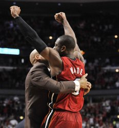 Heat's Wade celebrates against Bulls in Chicago