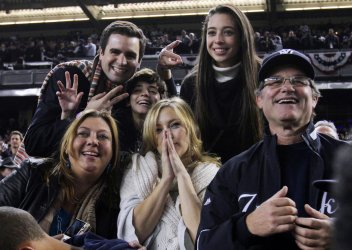 New York Yankee fans Kurt Russell and Kate Hudson react after the game against the Philadelphia Phillies in game 6 of the World Series at Yankee Stadium in New York