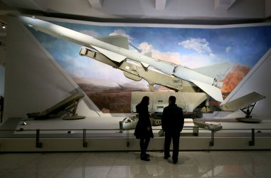 Visitors look at a ground-to-air missile in the Military Museum in Beijing, China