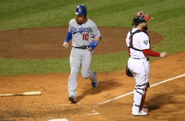 Dodgers' Justin Turner scores behind Red Sox's Sandy Leon during World Series Game 1