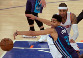 Charlotte Hornets Lamb can't stop pass by New York Knicks Anthony at Madison Square Garden
