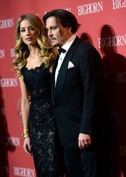 Amber Heard and Johnny Depp attend the Palm Springs International Film Festival in Palm Springs, California