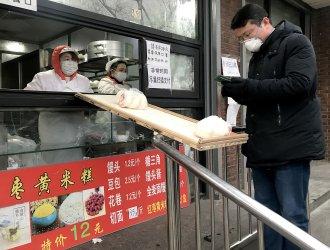 Dumpling shop uses makeshift bridge to deliver to customers in Beijing, China