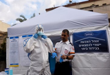 Israelis Demonstrate How Quarantined Voters Will Vote In National Election