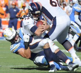 Chargers Joey Bosa sacks Broncos quarterback Trevor Siemian in Carson, California