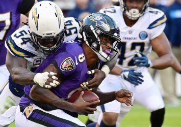 Ravens QB Lamar Jackson sacked for loss by Chargers' Melvin Ingram during an NFL Wild Card playoff game