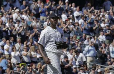 Fans applaud New York Yankees starting pitcher Michael Pineda after hit
