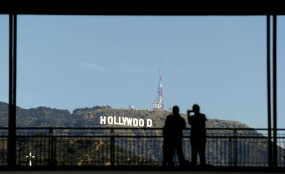 People photograph the Hollywood Sign in Los Angeles