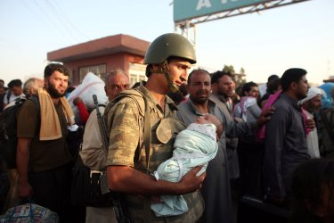 Syrians Refugees Flee From the Fighting At Turkish Border