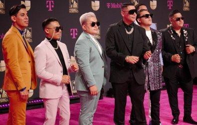 Grupo Firme walks the Red Carpet at Premio Lo Nuestro Award Show in Miami, Florida