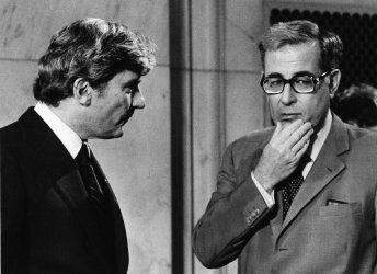 Defense Secretary Harold Brown confers with Sen. John Warner over the SALT II Treaty