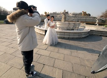 A Chinese couple poses for wedding photos in Beijing, China