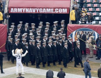 Navy midshipmen martch on to field during pregame ceremonies.