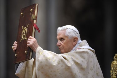 "Pope Benedict XVI celebrates Christmas mass at St. Peter's Basilica in Vatican City on December 24, 2011, to mark the nativity of Jesus Christ. Pope Benedict XVI hailed Christ's humility, urging the faithful to look beyond the Christmas ""glitter"" and ""enl"