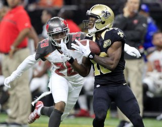 Brandin Cooks pulls in a Drew Brees pass for 42 yards against the Buccaneers
