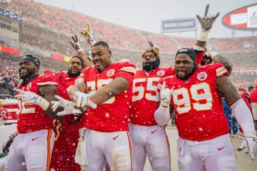 Chiefs players celebrate a victory over the Broncos