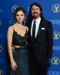 Musician David Grohl and his wife Jordyn Blum attend the 65th annual DGA Awards in Los Angeles