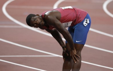 USA's Bromell waits for photofinish results in 100m semifinal at Summer Olympics in Tokyo, Japan