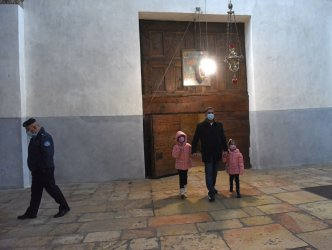 Palestinians Visit The Church of Nativity In Bethlehem On Christmas Eve