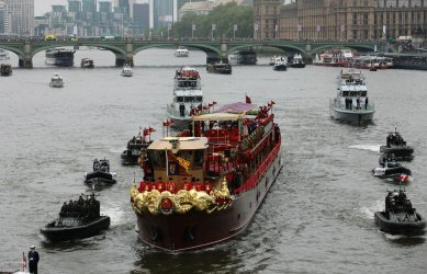 Riverboats sail down the River Thames for Royal Diamond Jubilee Pageant