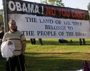 Israeli settlers hold a vigil in Jerusalem against U.S. President Barak Obama's demand to end settlement construction in the West Bank