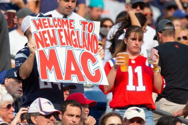 Patriots fan with sign