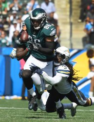 Eagles Ertz gains yardage on Chargers' Addae in Carson, California